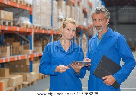 Portrait of man and woman in warehouse
