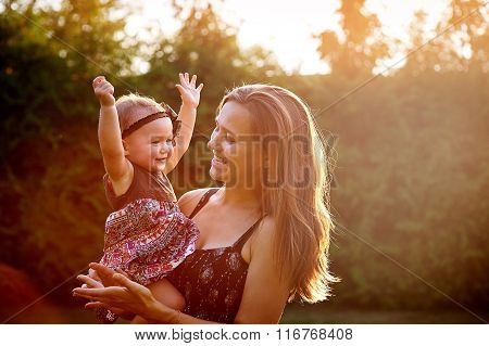 Mother With Little Daughter Walk In Park
