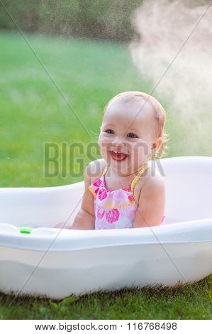 Little Girl Bathes In A Bath In Park