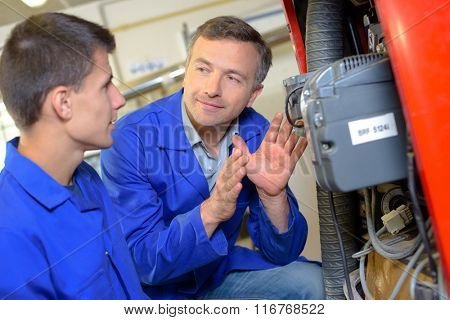 Man explaining equipment to trainee