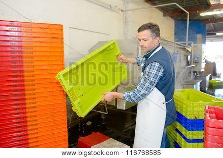 man stacking crates