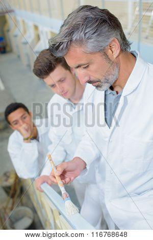 man painting railings