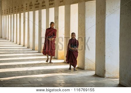 Buddhist monks walking at Shwezigon temple
