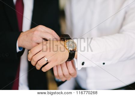 A Groom Is Getting Ready And Showing Watches