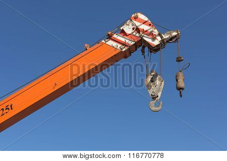 Crane Hook And Boom On Blue Skies Background.