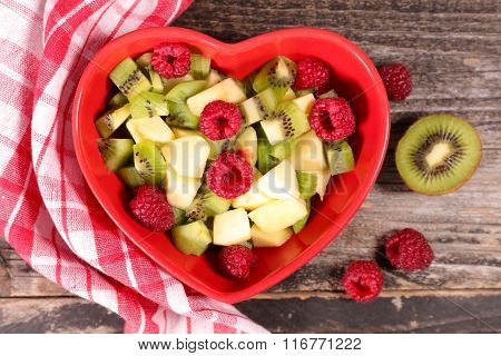 fruit salad in heart shaped bowl