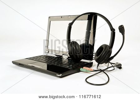 Headphones and a computer