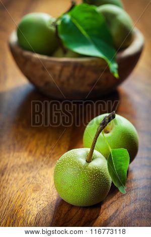 Non-GMO bio apples on wooden table