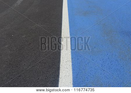 An Asphaltic New Road And Two Different Colored Lane.