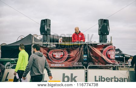 Dj playing music in a extreme obstacle race on park