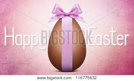 Easter Text With Chocolate Easter Egg And Pink Ribbon Bow