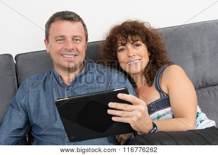 Forty Year Old Couple On App Tablet Pc Happy