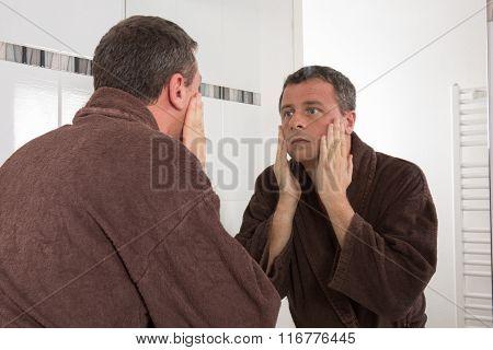 Man Looking At Himself