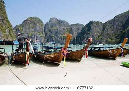 PHI PHI ISLANDS, THAILAND - CIRCA FEBRUARY, 2015: Tourist boats on the famous beach of Maya Bay on Phi Phi Leh island. It starred the popular movie The Beach with the actor Leonardo DiCaprio