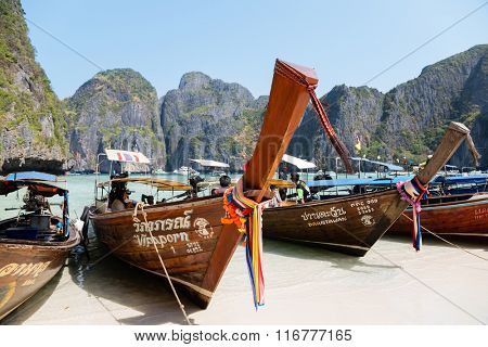 PHI PHI ISLANDS, THAILAND - CIRCA FEBRUARY, 2015: Traditional Thai boats on the beach of Maya Bay on Phi Phi Leh. It starred the popular movie The Beach with the actor Leonardo DiCaprio