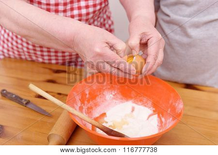 The grandmother and the grandson bake