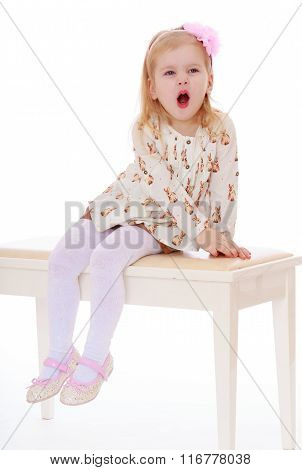 Girl sitting on a stool