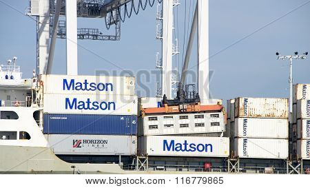 Crane Operator Working On Adjusting Stuck Shipping Container Aboard Matson Cargo Ship Manoa