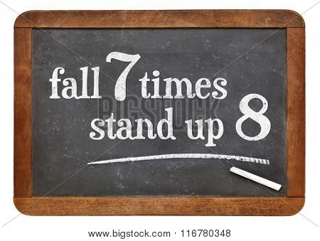 Fall seven times, stand up eight. Japanese proverb on vintage blackboard. Determination concept.