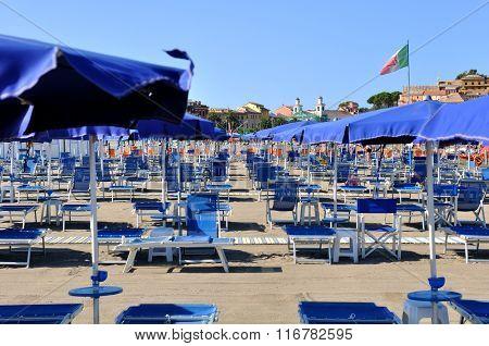 Blue Umbrellas And Sunbeds