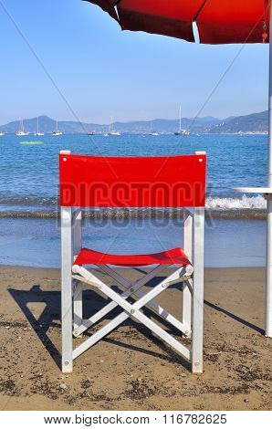 Red Chair Front Of The Sea