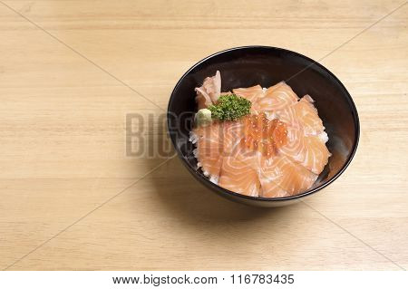 Salmon Ikura Don On The Wood Table.