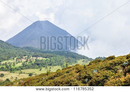 The Hazy Landscape With The Peak Of The Active Izalco Volcano In El Salvador