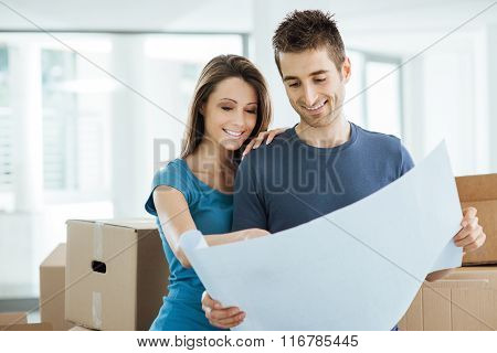 Young Couple Planning Their New House