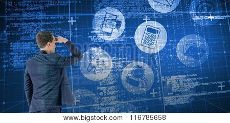Wear view of businessman looking away against blue matrix and codes