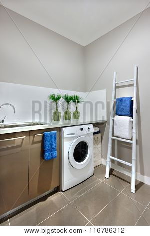 A Washing Area With A Washing Machine Of A Modern House