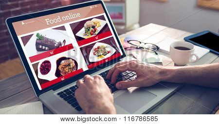 Food app against cropped hand of graphic designer using laptop