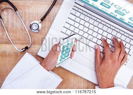 Medical app against doctor using smartphone and laptop on wooden desk