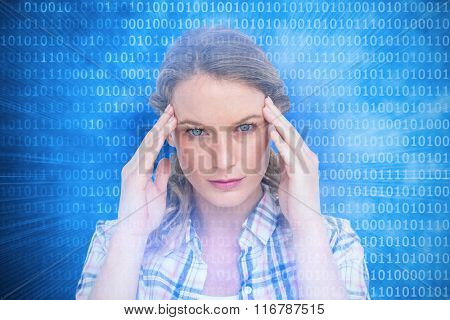 Pretty hipster with headache against glowing futuristic binary code