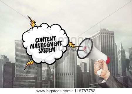 Content management system text on speech bubble and businessman hand holding megaphone