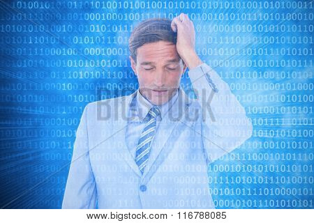 Stressed businessman getting a headache against glowing futuristic binary code
