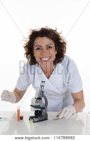 Happy Woman In A Medical Lab With A Microscope