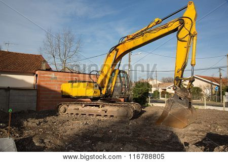 Big Excavator On Construction Site, Under Blue Sky And Sun
