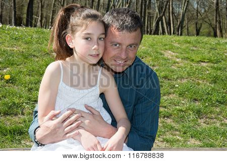 Girl Hugging Her Father - Outside At The Park