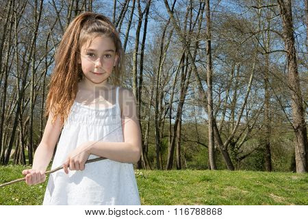 Little Girl  Breathes The Fresh Air In The Park.