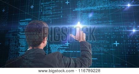 Businessman pointing with his fingers against blue matrix and codes