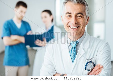 Confident Doctor At Hospital Posing