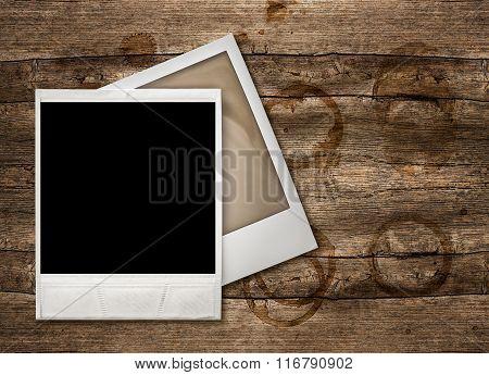 Photo Frames Over Wooden Background