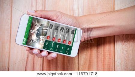 Sport app against feminine hand holding smartphone