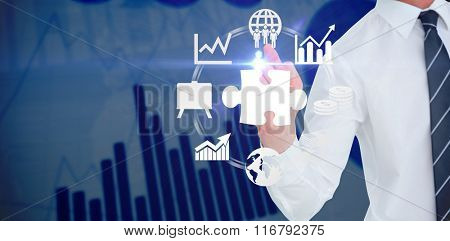 Businessman pointing with his finger against blue data
