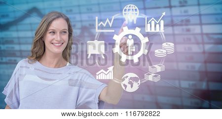 Pretty woman pointing with her finger against blue data