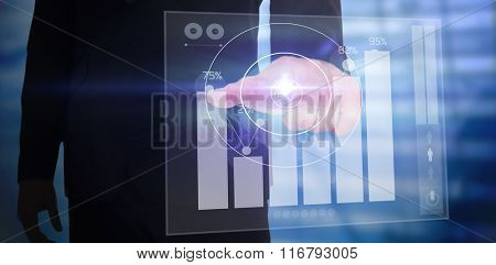 Businessman pointing with finger against percentages graphical representation