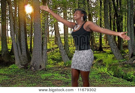Black Woman Standing In A Spring Forest