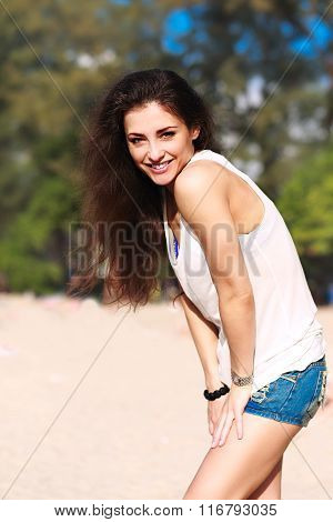 Beautiful Happy Woman In Fashion Shorts And White Top Posing On Beach Background
