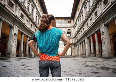 Sporty Female Staying In Front Of Uffizi Gallery, Florence