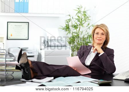 Relaxing mature business woman.